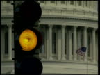 Washington DC EXT CMS traffic light changing from amber to red with US flag and the White House in the b/g SIDE policeman at security checkpoint LS...