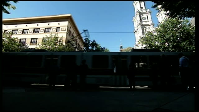 EXT Streetcar along Reporter to camera