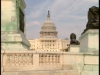 WS, USA, Washington, D.C., United States Capitol, banister and lions statues in foreground