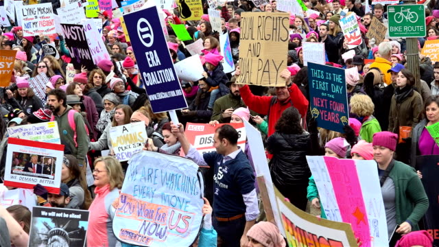 Washington DC UNITED STATES – JANUARY 21 2017 Hundreds of thousands of people took part in the Women's March in Washington on Jan 21 to protest US...