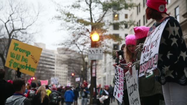 A woman chants 'We need a leader not a crooked traitor' while holding a sign reading 'I'm just sick of being assaulted' during the Women's March on...