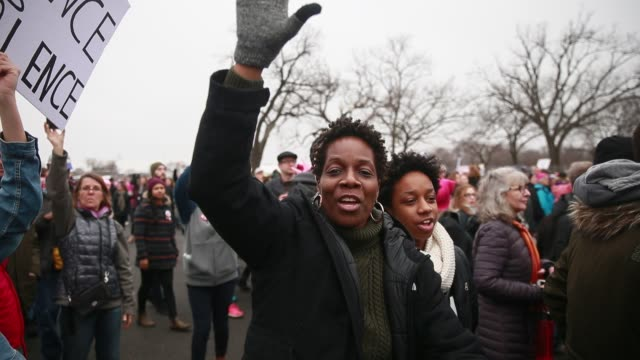 Women begin a march down Constitution Avenue passing the Washington Monument chanting 'We are the popular vote' even though authorities tried to...