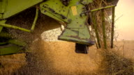 SLO MO Waste Straw Under A Combine