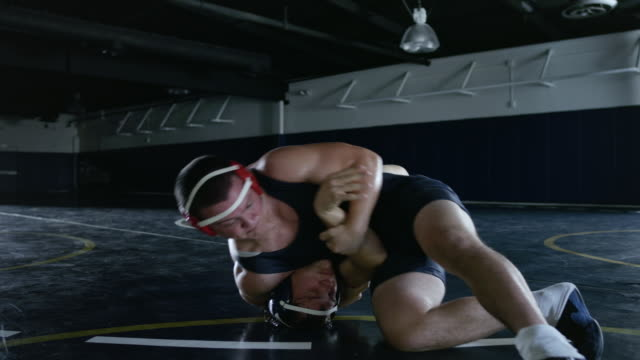 MS Wastlers struggle head to head and  taken down into headlock in wrestling match / Riverside, California, United States