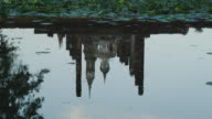 Wat Mahathat at the Historical Park, SUKHOTHAI, Thailand. Tilt up from reflection in water