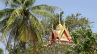 Wat Na Phra Lan temple with palm trees