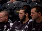 watches from the bench as Liverpool play Hull City in a preseason friendly match in July 2011 Andy Carroll at Anfield on September 20 2011 in...