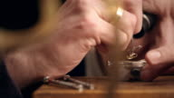Watchmaker assembling watch