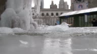 Water barely trickles through an ice encased water fountain in Bryant Park NYC during a record outbreak of cold weather