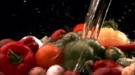 CU, Water being poured into assorted vegetables