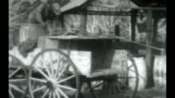 A water carrier uses his horse and wagon to pump water from the well / The water is also used for irrigating the orchard