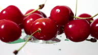 Water droplets fall on top of cherries