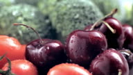 Water droplets on fresh cherry and vegitables