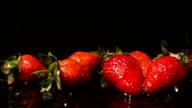 Water Drops Falling On Strawberries