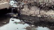 Water Flowing Through Garbage Dump
