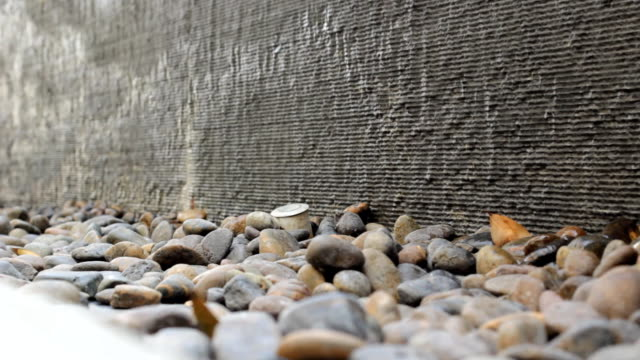 Water flows along a stone wall