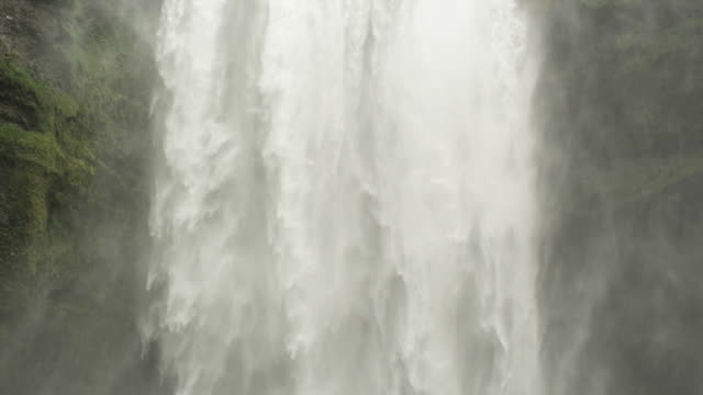 Water flows down the spectacular Skogafoss waterfall in Iceland.