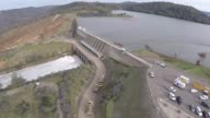Water flows over a spillway at the Oroville Dam as an emergency measure after authorities warned that a spillway damage in North America's tallest...