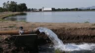 Water is pumped into an irrigation canal on May 8 2015 in Biggs California As California enters its fourth year of severe drought farmers are...