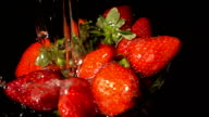 Water Pouring On Strawberries