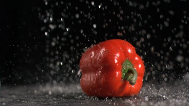 Water raining on pepper in super slow motion