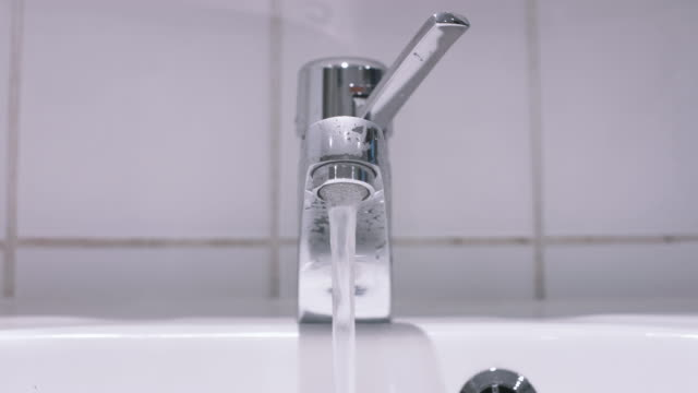 Water Running from Bathroom Sink Faucet