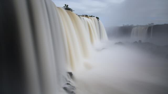 TL, MS Water rushes down Iguacu Falls / Foz do Iguacu, Brazil