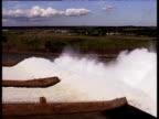Water rushes through turbines of Itaipu Dam