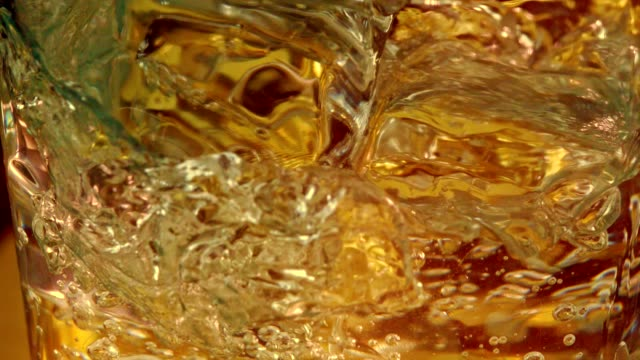 Water splashing into ice cubes - Close up
