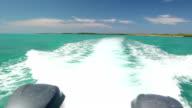 Water Spray splashing from speedboat on beautiful blue sea