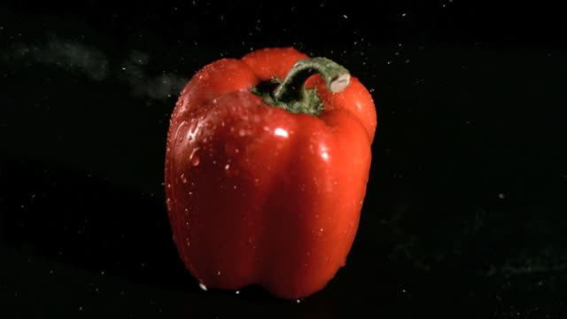 Water sprayed on pepper in super slow motion