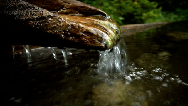 Water Springs from a Wooden Fountain