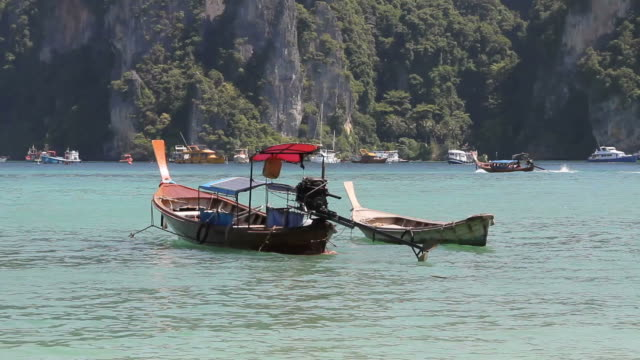 Water taxi floating on the sea (Phiphi Island, Krabi, Thailand).