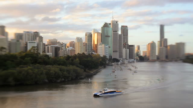 Water taxi on Brisbane River with city skyline, Queensland, Australia, Southern Hemisphere