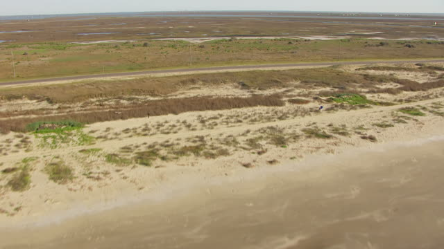 WS AERIAL LA water to reveal beach and Gulf Coast / Follets Island, Texas, United States