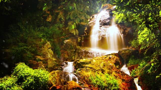 Waterfall and sun glitter