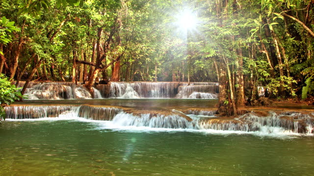 Waterfall and sun