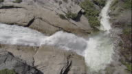 A waterfall crashes down a steep, rocky cliff in Yosemite National Park. Available in HD.