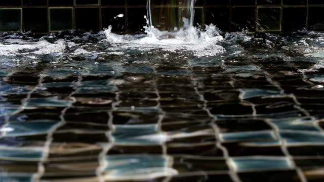 waterfall decorated in swimming pool