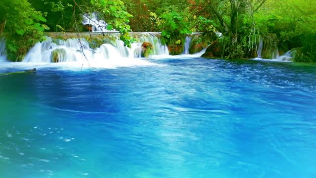 Waterfall in blue lake