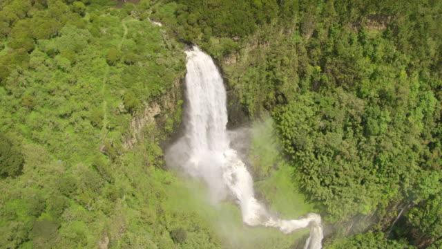 WS AERIAL Waterfall in dense rainforest / Kenya