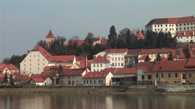WS PAN Waterfront of old town along River Drava with view of Ptuj Castle, also known as Ptujski Grad / Ptuj, Stajerska, Slovenia