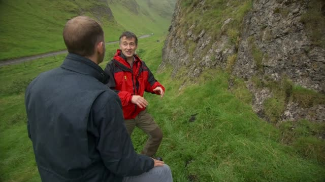 Waterlicht installation in Peak District Chris Millner and ITN Reporter along in valley as Millner talks about formation of valley SOT Drone Aerial...