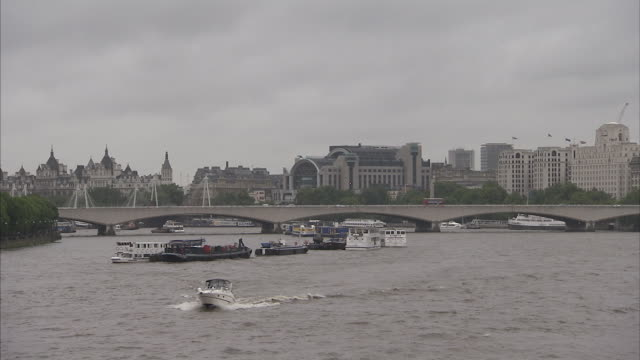 Waterloo Bridge spans the River Thames London Available in HD.