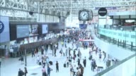 Waterloo Station platforms reopen after expansion ENGLAND London Waterloo INT Wide shot Waterloo station Passengers along Guard standing by ticket...