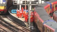 Waterloo Station platforms reopen after expansion T15081733 / TX Various of workers on tracks by derailed train