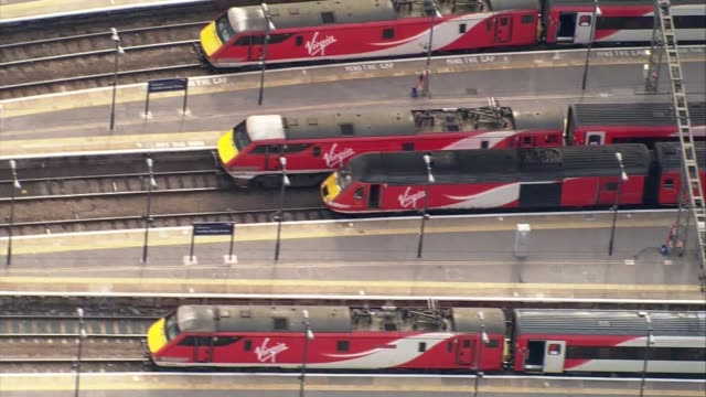 Aerial views AERIALS River Thames / Westminster Palace / Buckingham Palace / West End / St Pancras Station / Kings Cross Station / trains on...