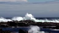 Wave crashes against rock