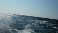 HD: Wave flows behind a boat