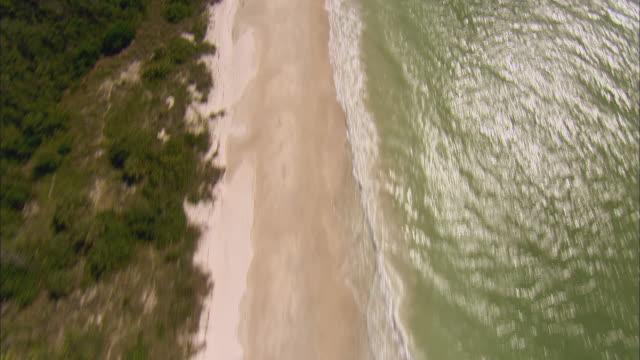 AERIAL WS Waves breaking on beach / Bonita Springs, Florida, USA